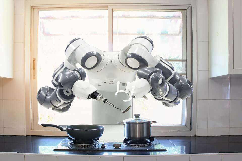robot chef cooking in a robotic kitchen