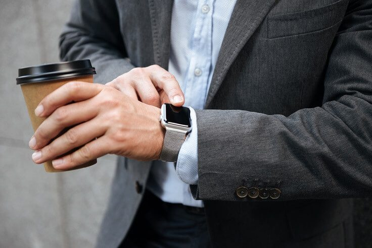 A business man is using smartwatch