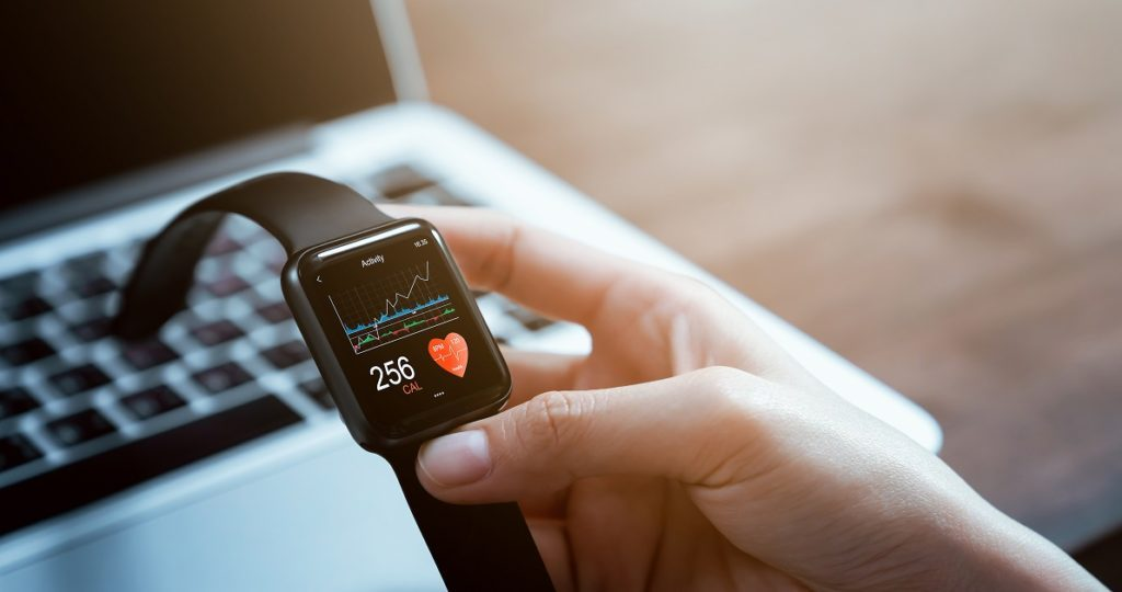 Smartwatch with health app on the screen, gadget for fitness active lifestyle.